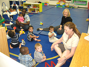 Visitors read to children and play with them